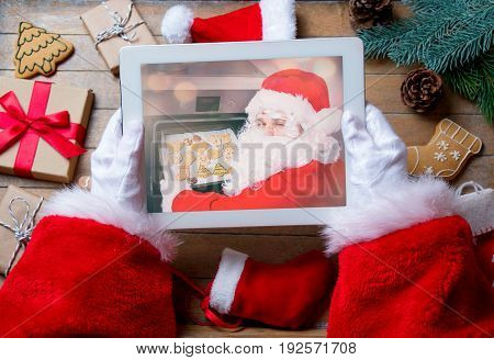 Santa Claus Holding Tablet Device