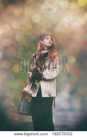 Woman In Fur Coat With Valise