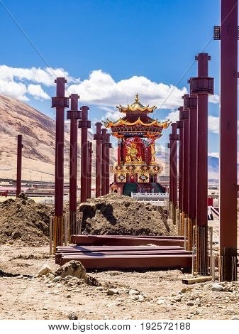Under construction of buddha image in Yarchen Gar Monastery in Sichuan China