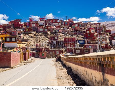 Shacks of buddhist monks on the hill in Yarchen Gar Monastery in Sichuan China