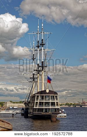 SAINT-PETERSBURG, RUSSIA - 23 JUNE 2017: View of the Neva river and the floating restaurant frigate Blagodat at the Petrovskaya Embankment