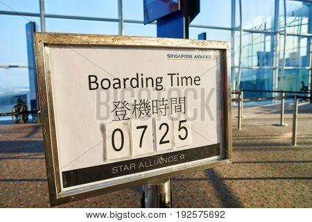 HONG KONG - CIRCA SEPTEMBER, 2016: boarding time sign at Hong Kong International Airport.