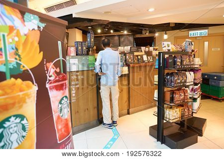 HONG KONG - CIRCA SEPTEMBER, 2016: customer ordering coffee at Starbucks coffee shop in Hong Kong. Starbucks Corporation is an American coffee company and coffeehouse chain.