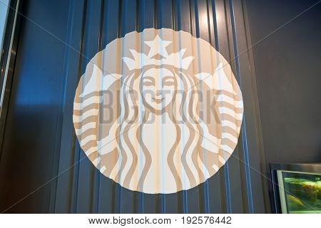 HONG KONG - CIRCA SEPTEMBER, 2016: close up shot of Starbucks logo on a wall in Hong Kong. Starbucks Corporation is an American coffee company and coffeehouse chain.