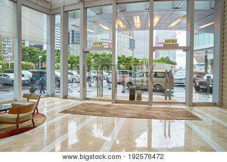 HONG KONG - CIRCA SEPTEMBER, 2016: exit from Four Seasons Hotel Hong Kong. Four Seasons Hotel Hong Kong is a five-star hotel building in the Sun Hung Kai Properties.