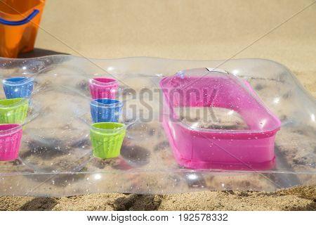 An air mattress on sand beach close up