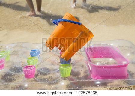 Air mattress and a basket on sand beach