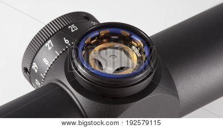 Slot that holds a battery on a rifle scope with a lighted reticle