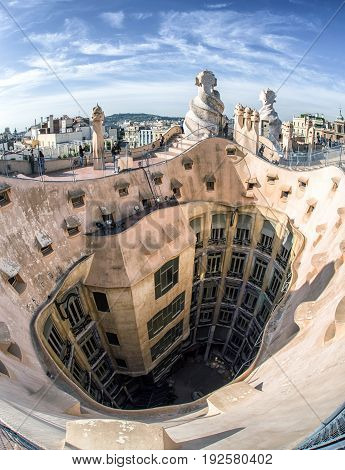 BARCELONA SPAIN - APRIL 20: Roof of modernist house Casa Mila also known as La Pedrera designed by Antoni Gaudi on April 20 2017 in Barcelona