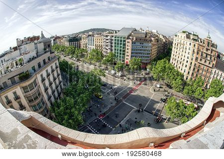 BARCELONA SPAIN - APRIL 20: Centre of city from roof of modernist house Casa Mila also known as La Pedrera designed by Antoni Gaudi on April 20 2017 in Barcelona