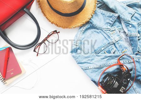 Flat lay of woman traveler items and passport on white background Travel and Lifestyle concept