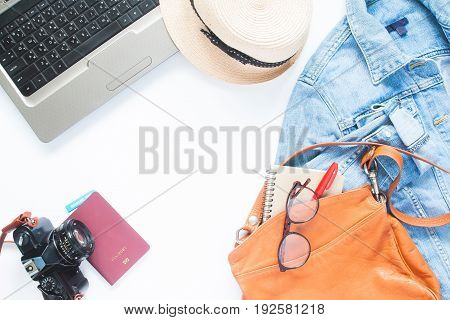 Creative high angle view of travel concept with teenager items and laptop on white background Travel planning