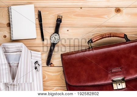overhead view of business accessories and Businessman outfit on wooden background