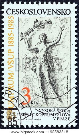 CZECHOSLOVAKIA - CIRCA 1985: A stamp printed in Czechoslovakia issued for the Centenary of Prague University of Applied Arts shows Art and Pleasure (Jan Simota), circa 1985.