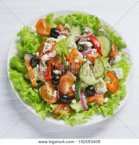 Fresh vegetable Greek salad white background top view