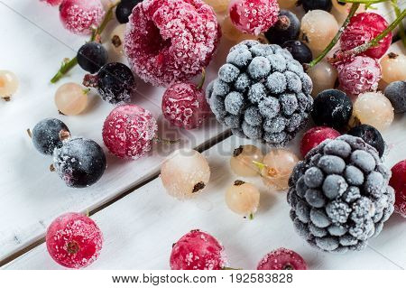 frozen berries: black currant red currant black berry blueberry white currant. top view macro.