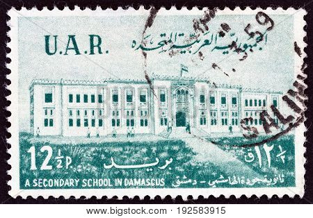 UNITED ARAB REPUBLIC SYRIA - CIRCA 1959: A stamp printed in Syria shows Al-Haschimi Secondary School, Damascus, circa 1959.