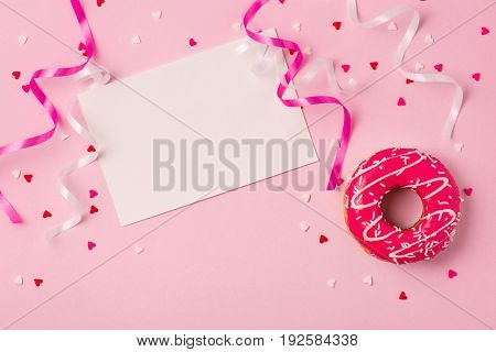 Donuts With Icing On Pastel Pink Background With Copyspace. Sweet Donuts.