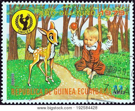EQUATORIAL GUINEA - CIRCA 1979: A stamp printed in Equatorial Guinea issued for the International Year of the Child shows child and fawn, circa 1979.