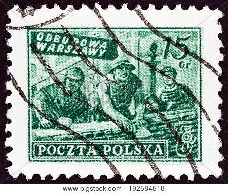 POLAND - CIRCA 1950: A stamp printed in Poland shows rebuilding Warsaw, circa 1950.