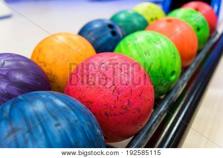 A colorful bowling balls in return machine