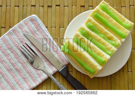 bread dressing butter and pandanus custard sauce on plate
