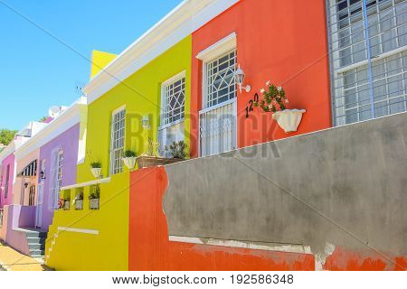 Cape Town, South Africa - January 11, 2014: The colorful houses of Bo-Kaap, famous Malay Quarter is the Muslim Malay village in Cape Town, one of the most picturesque part of town.