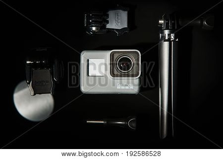 Kharkov, Ukraine - April 13, 2017: GoPro HERO 5 action camera set top view on black background. Compact gadget waterproof, support 4k video, voice controls and is often used in extreme photography