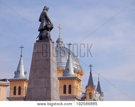 Kosciuszko and crosses. Lodz, Poland - June 24, 2017 Monument of Tadeusz Kosciuszko on the background of the church tower. Spirit on Freedom Square in Lodz.