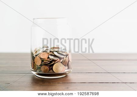 Coins and plant in glass business investment growth and saving concept.