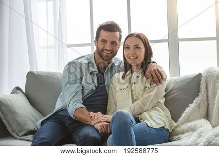 Young woman and man family couple indoors love