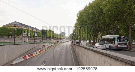 ParisFrance- April 29 2017: On the quay of the Tuileries towards the Louvre.Tourists and transport are moving along the embankment
