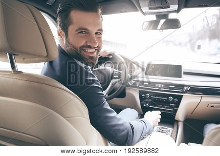 Young business person test drive new vehicle happy