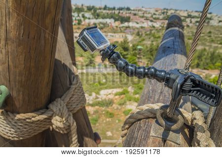 Action camera on stick on climbing tower.
