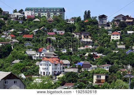 Residential area in the mountains. Houses on the picturesque mountain slope.
