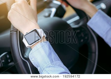 Woman transportation by modern eco car smart watch