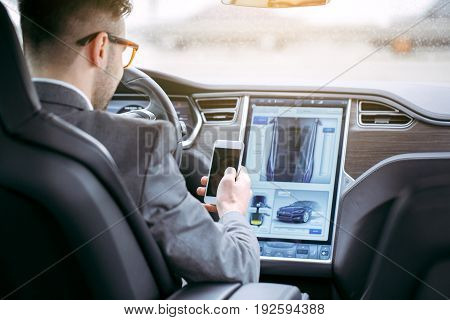 Man transportation by modern eco car using smartphone