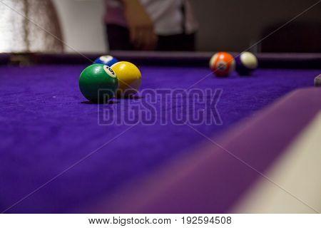 Many billiard balls in a pool table.