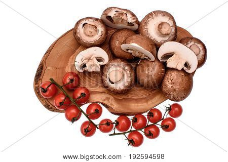 Gray Mushrooms Champignons And Cherry Tomatoes Lie On A Wooden Board Of Drying Oil, Isolated On Whit