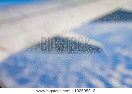 Frozen Condensation Of Ice Crystals On The Window Of An Airplane With The Wing In The Back