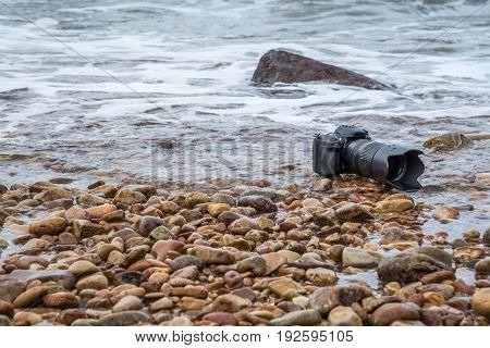 Camera On A Beach It Wet From Sea Wave