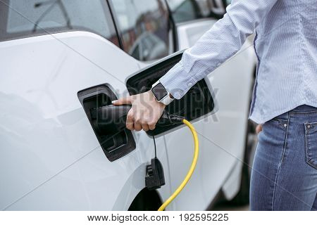 Woman transportation by modern eco car charge energy