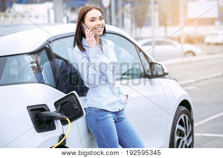 Woman transportation by modern eco car phone call