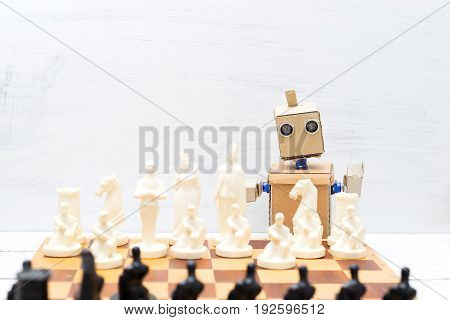 Robot with hands playing chess. Artificial Intelligence