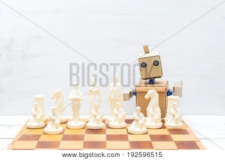 The robot with hands plays chess. Artificial Intelligence