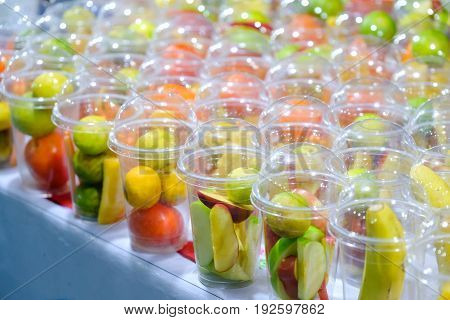 refreshing summer drink Smoothies with Orange cucumber Apple in glasses. in Local Market Thailand