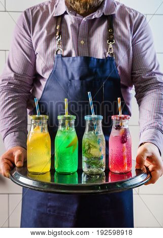 chef with summer drinks