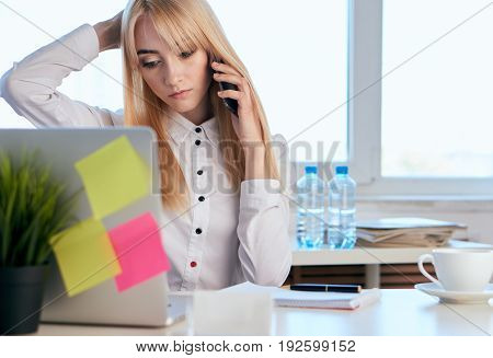 Businesswoman, office, woman working on the computer, calling on the phone, blonde, busy girl.