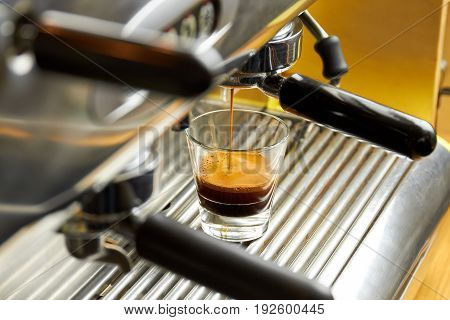 Coffee machine pouring espresso. Drink with foam. Kitchen appliances sale.
