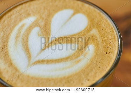 Latte art macro. Coffee foam flower picture.